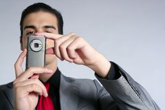Businessman taking photos with phone camera Royalty Free Stock Images