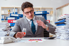 The businessman taking pills to cope with stress Stock Photo