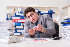 The businessman taking pills to cope with stress Stock Photography