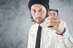 Businessman taking self portrait with mobile phone Stock Photos