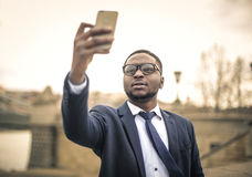 Businessman taking a selfie Stock Photography