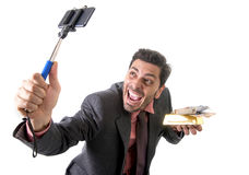 Businessman taking selfie photo with mobile phone camera and sti Royalty Free Stock Photography