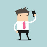 Businessman taking selfie using a mobile phone Stock Images