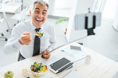 Businessman taking selfies during his lunch break Stock Photography