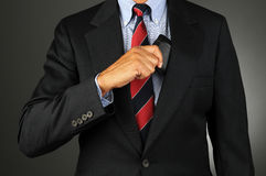 Businessman Taking Wallet From Inside Coat Pocket Stock Image
