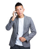 Businessman talk to cellphone Stock Photography