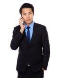 Businessman talk to cellphone Royalty Free Stock Photos