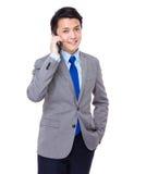 Businessman talk to cellphone Stock Image