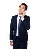 Businessman talk to cellphone Stock Photos