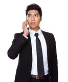Businessman talk to cellphone Stock Photos