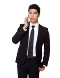 Businessman talk to cellphone Stock Photo
