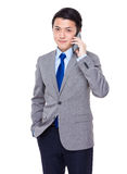 Businessman talk to cellphone Royalty Free Stock Photography