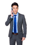 Businessman talk to cellphone Royalty Free Stock Photos