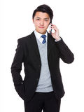Businessman talk to cellphone Stock Images