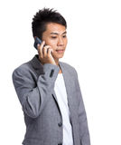 Businessman talk to mobile phone Royalty Free Stock Photos