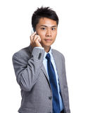 Businessman talk to mobile phone Stock Photography