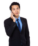 Businessman talk to mobile phone Royalty Free Stock Photo