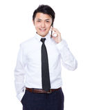 Businessman talk to mobile phone Royalty Free Stock Photography