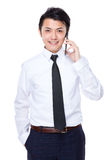 Businessman talk to mobile phone Royalty Free Stock Images