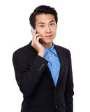 Businessman talk to mobile phone Stock Photos