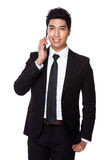 Businessman talk to phone Royalty Free Stock Images