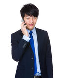 Businessman talk to phone Stock Photo