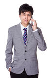 Businessman talk to phone Stock Images