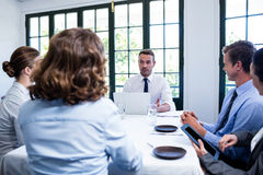 Businessman talking in a business meeting Stock Photos