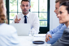 Businessman talking in a business meeting Stock Photography