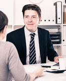 Businessman talking about business with woman Stock Photography