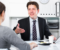Businessman talking about business with woman Royalty Free Stock Photos