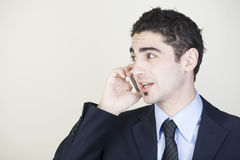 Businessman talking on cell phone. Good-looking businessman talking on cell phone royalty free stock images