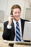 Businessman talking on cell phone. Businessman talking on a cell phone Stock Images