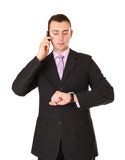 Businessman talking on a cell phone Stock Images