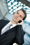 Businessman talking on the cell phone Stock Image