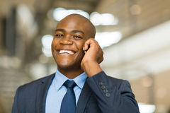 Businessman talking cell phone Stock Photos