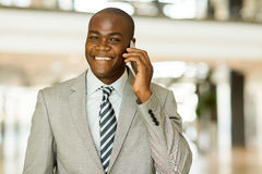 Businessman talking cell phone Stock Photo