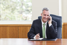 Businessman talking on a cell phone royalty free stock photography