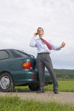 Businessman talking on cell phone beside his car Royalty Free Stock Photo