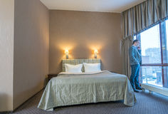Businessman talking on cell phone in hotel room Royalty Free Stock Images