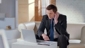 Businessman talking on cell phone in modern office, solving company issues stock photos