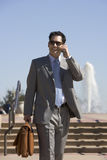 Businessman talking on cell phone outdoors Royalty Free Stock Images