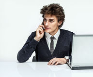 Businessman talking by cell phone Royalty Free Stock Images