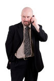 Businessman talking on cellphone Royalty Free Stock Images