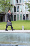 Businessman talking on cellphone outdoor Royalty Free Stock Photography