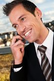 Businessman talking on cellphone outside Stock Photos