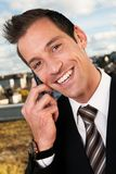 Businessman talking on cellphone outside Royalty Free Stock Image