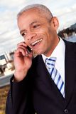 Businessman talking on cellphone outside Stock Image
