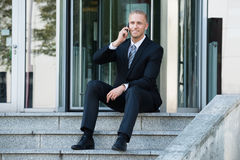Businessman Talking On Cellphone Stock Images