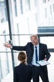Businessman talking with colleague Stock Images
